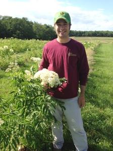 Kurt Garretson with elderberry plants at East Grove Farm in southeast Iowa. Photo courtesy of East Grove Farm.